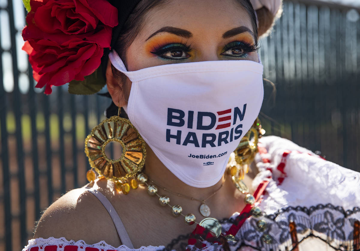Marisol Hernandez shows off her mask at a democratic event to promote early voting at the East ...