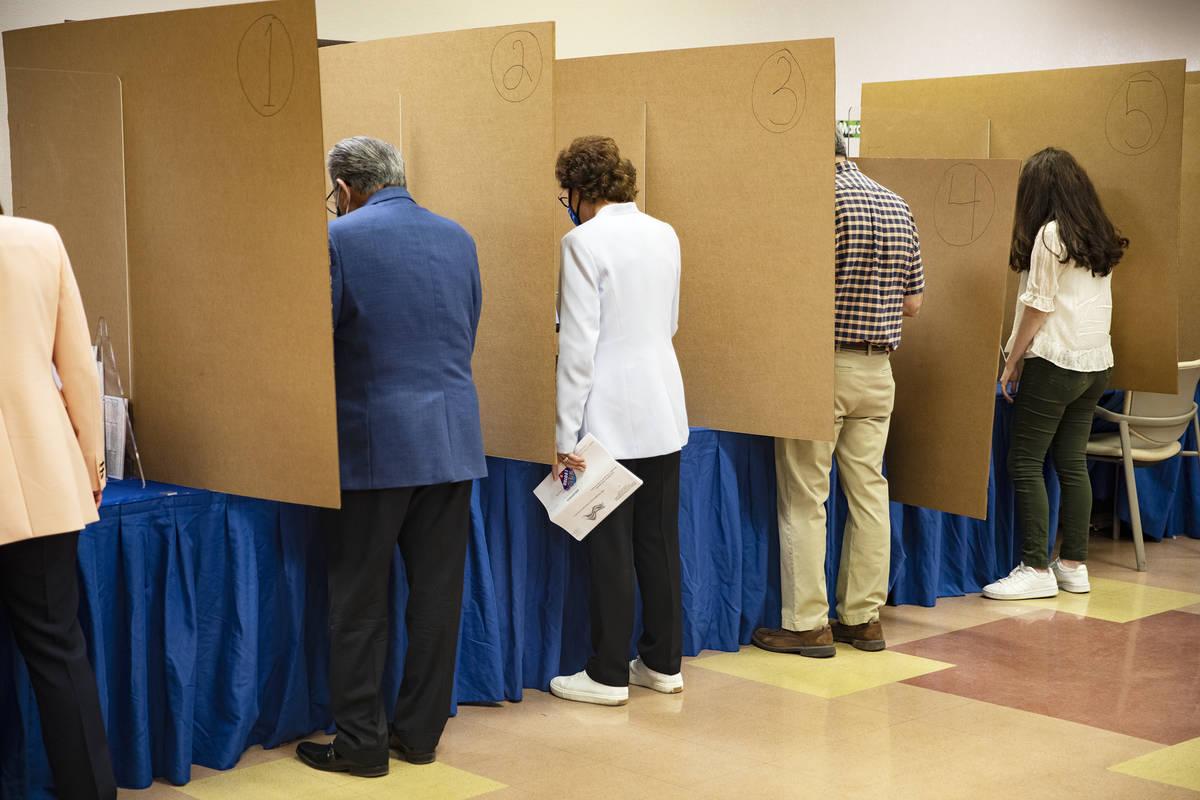 Sen. Jacky Rosen, D-Nev., third from left, votes at the East Las Vegas Community Center in Las ...