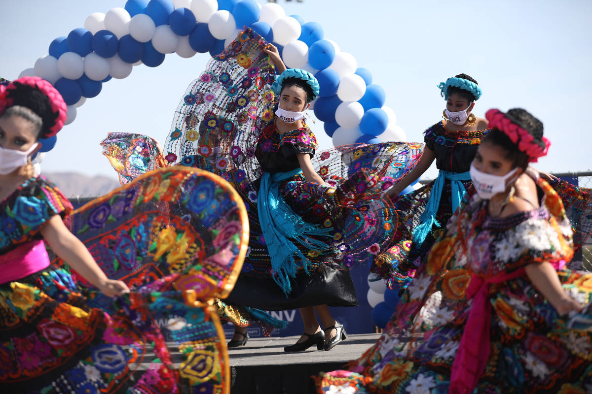Members of the Mexico Vivo Dance Company perform at a democratic event to promote early voting ...