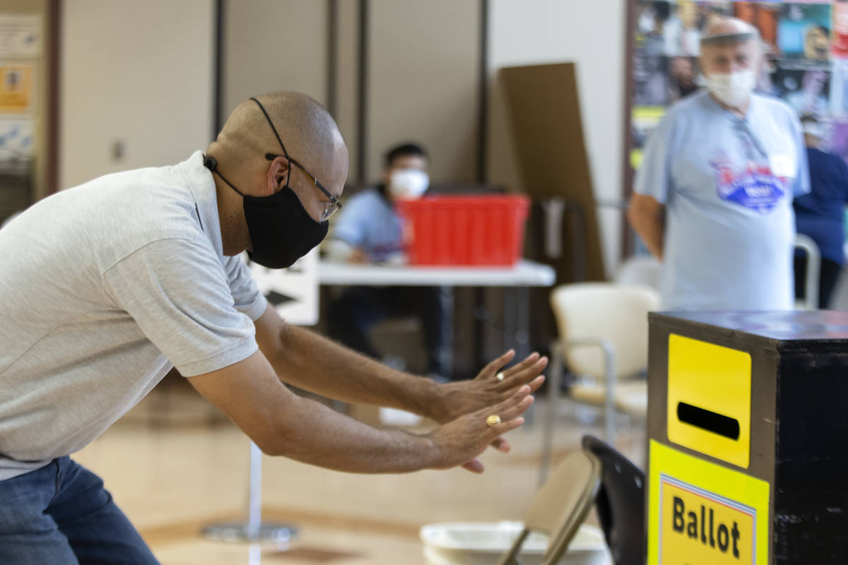 Nevada Attorney General Aaron Ford casts his ballot at Doolittle Community Center on Sunday, Oc ...