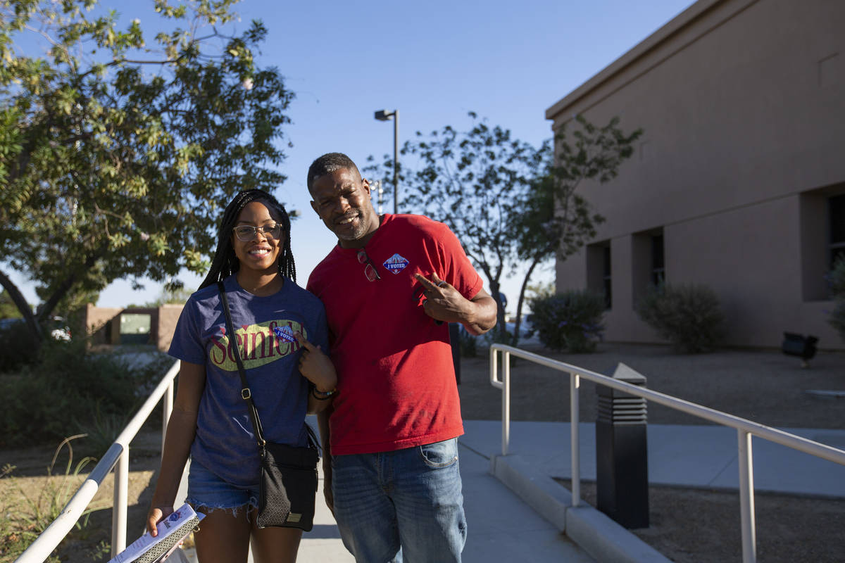 Father and daughter Larry Wilson and Tatyana Wilson poses for a portrait after voting at the Ea ...