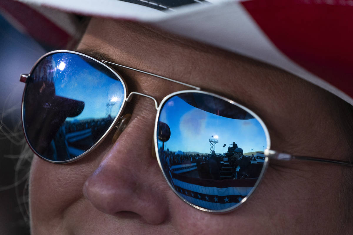 President Donald Trump is reflected in a supporter's sunglasses as he speaks at a campaign rall ...