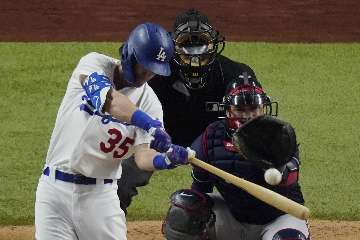 Los Angeles Dodgers' Cody Bellinger hits a home run against the Atlanta Braves during the seven ...