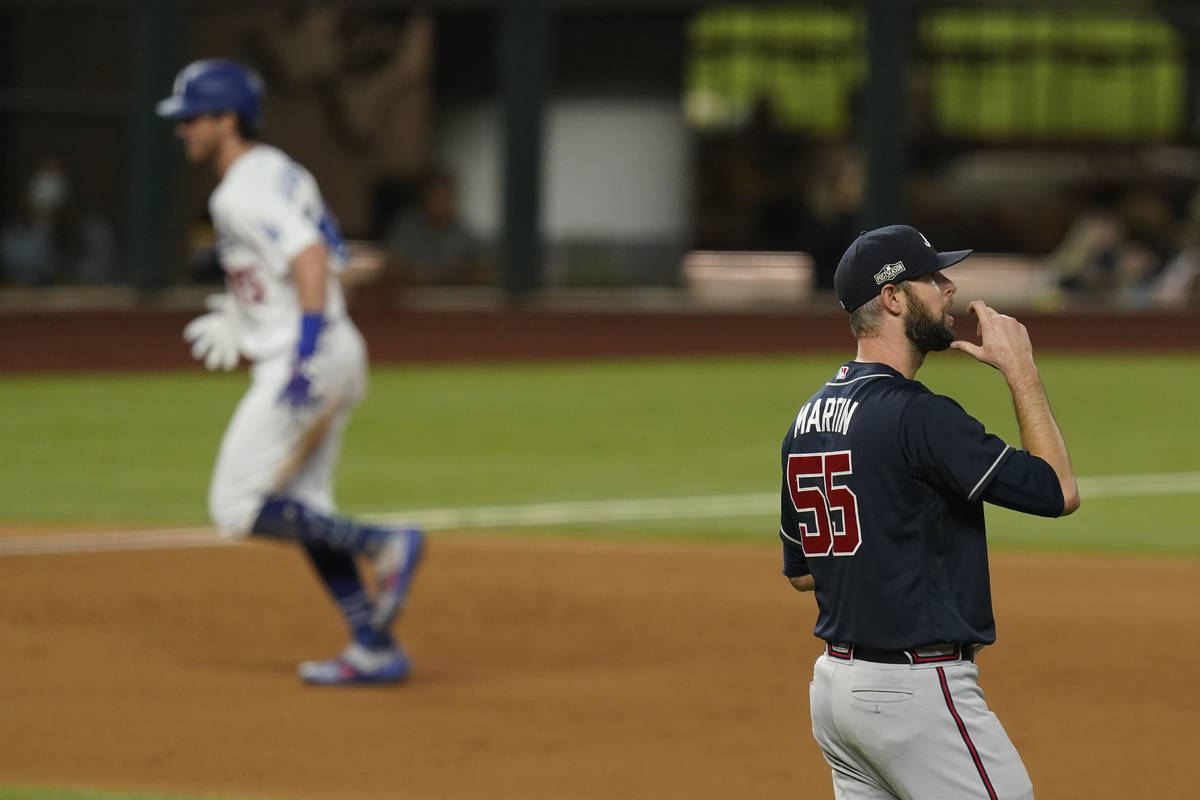 Los Angeles Dodgers' Cody Bellinger rounds the bases after a home run off Atlanta Braves relief ...