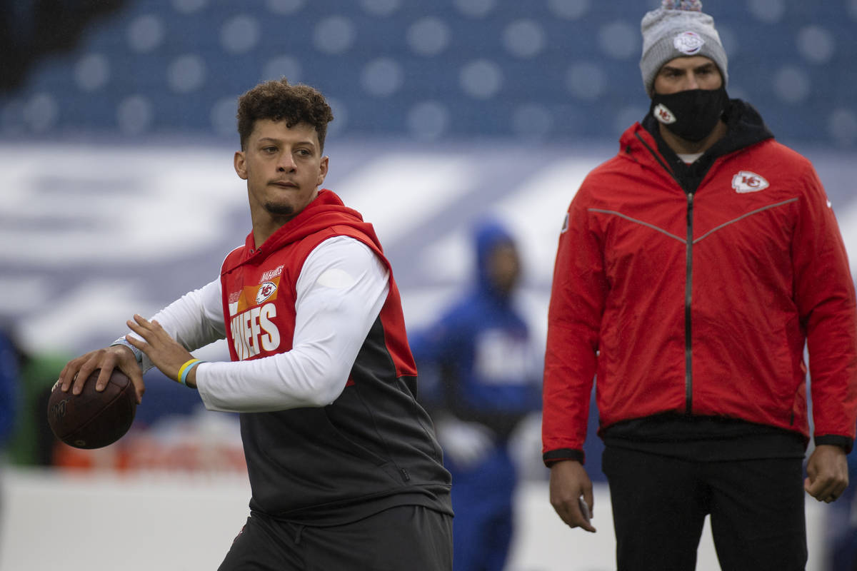 Kansas City Chiefs quarterback Patrick Mahomes (15) warms up before an NFL football game agains ...