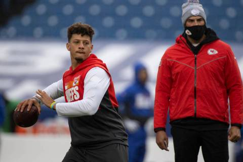 Kansas City Chiefs quarterback Patrick Mahomes (15) warms up before an NFL football game agains ...