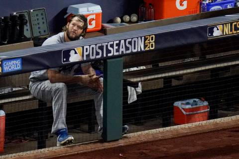 Los Angeles Dodgers starting pitcher Clayton Kershaw sits in the dugout after leaving the game ...