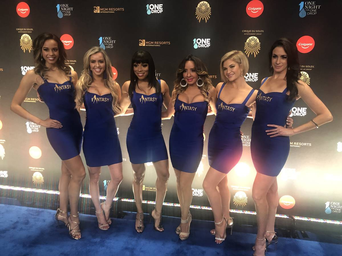"""The cast of """"Fantasy"""" at Luxor is shown on the Blue Carpet prior to """"One Night For One Drop,"""" h ..."""