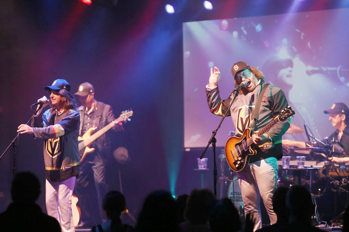 David Scott as Robin Gibb of the Australian Bee Gees, a Bee Gee tribute band, left, and Michael ...