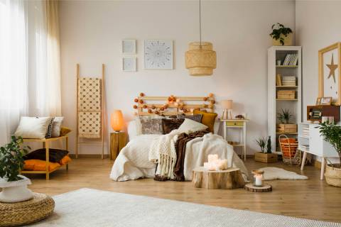 Weave decorative pillows and throw blankets in the bedroom and layer autumn orange, brown and n ...