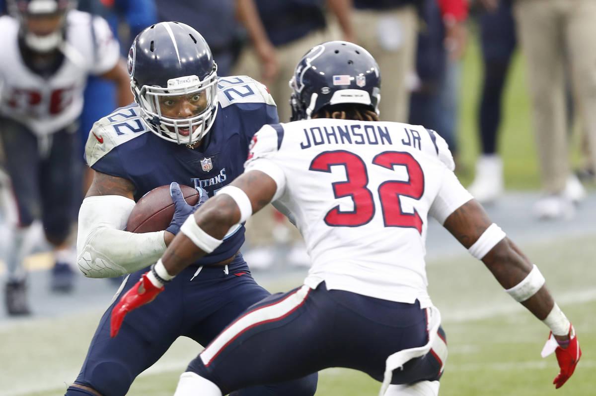 Tennessee Titans running back Derrick Henry (22) carries the ball against Houston Texans corner ...