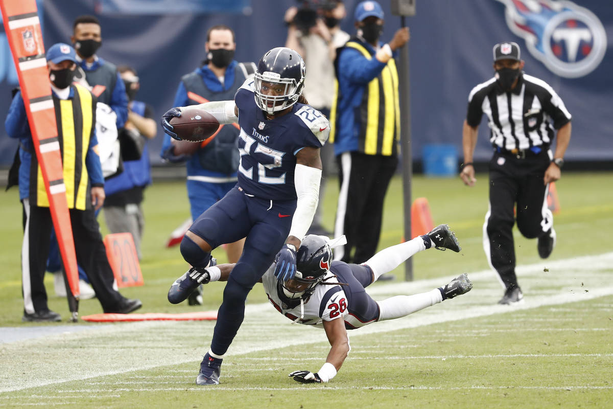 Tennessee Titans running back Derrick Henry (22) carries the ball past Houston Texans cornerbac ...