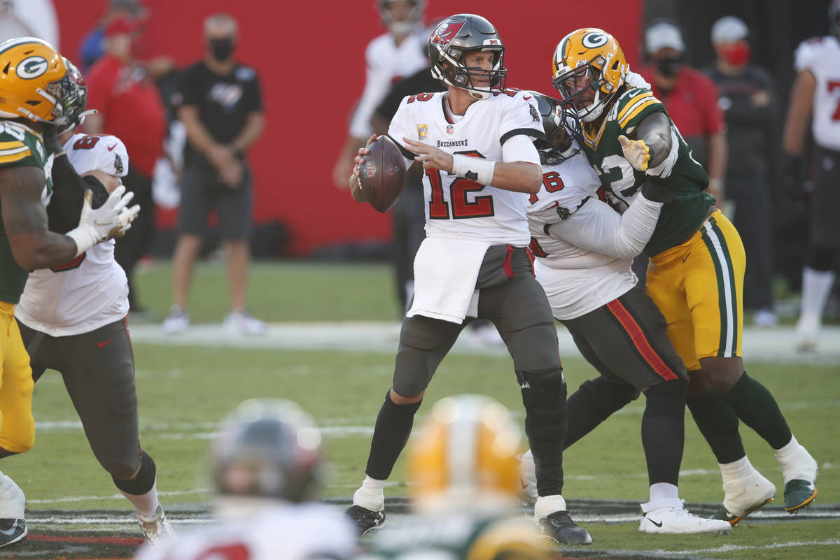 Tampa Bay Buccaneers quarterback Tom Brady (12) looks to throw a pass against the Green Bay Pac ...