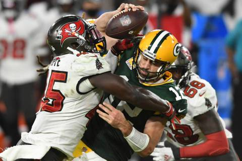 Tampa Bay Buccaneers inside linebacker Devin White (45) sacks Green Bay Packers quarterback Aar ...