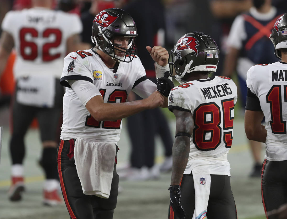 Tampa Bay Buccaneers quarterback Tom Brady (12) celebrates with wide receiver Jaydon Mickens (8 ...