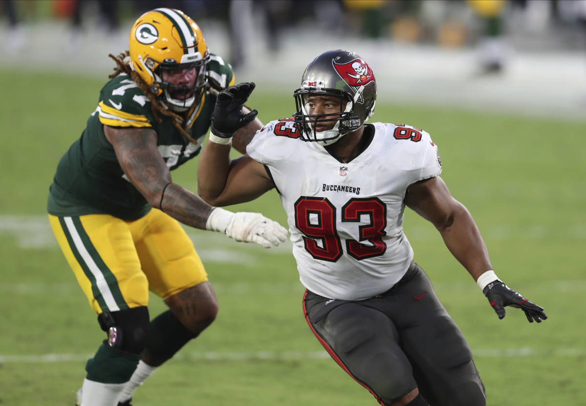 Tampa Bay Buccaneers defensive end Ndamukong Suh (93) works around Green Bay Packers offensive ...