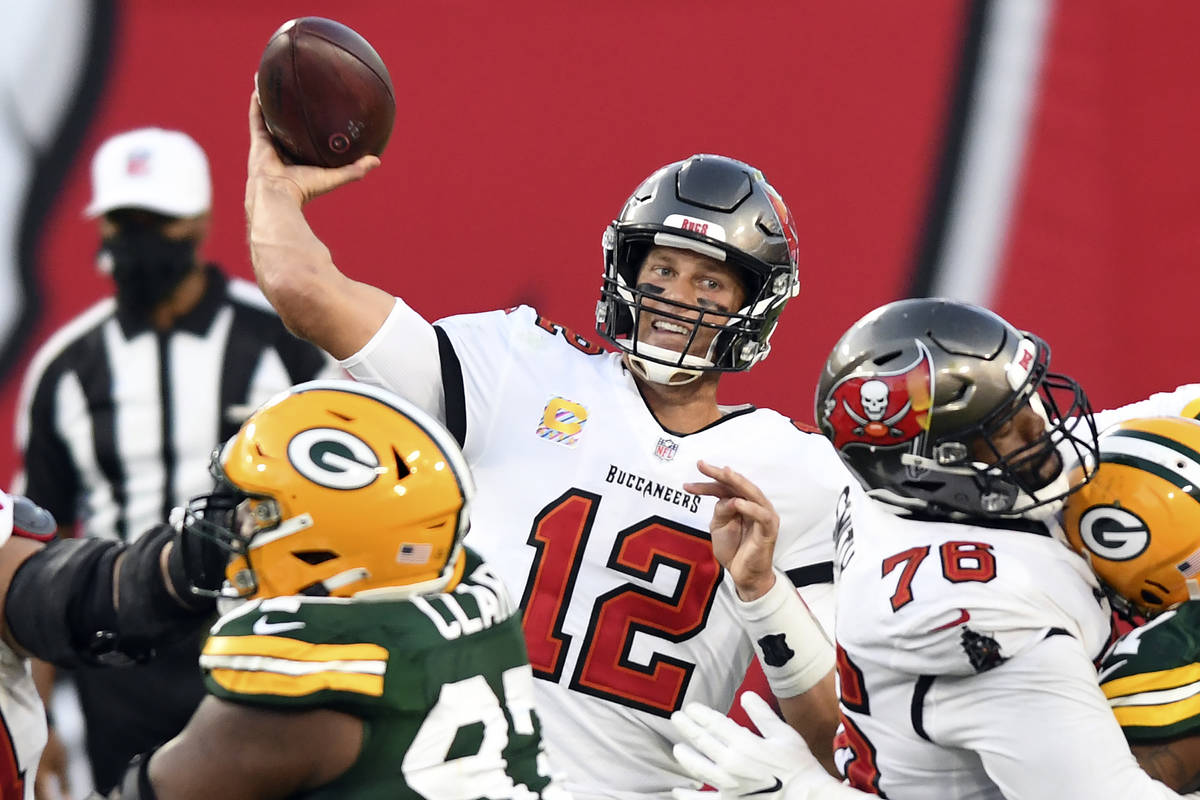 Tampa Bay Buccaneers quarterback Tom Brady (12) throws a pass against the Green Bay Packers dur ...