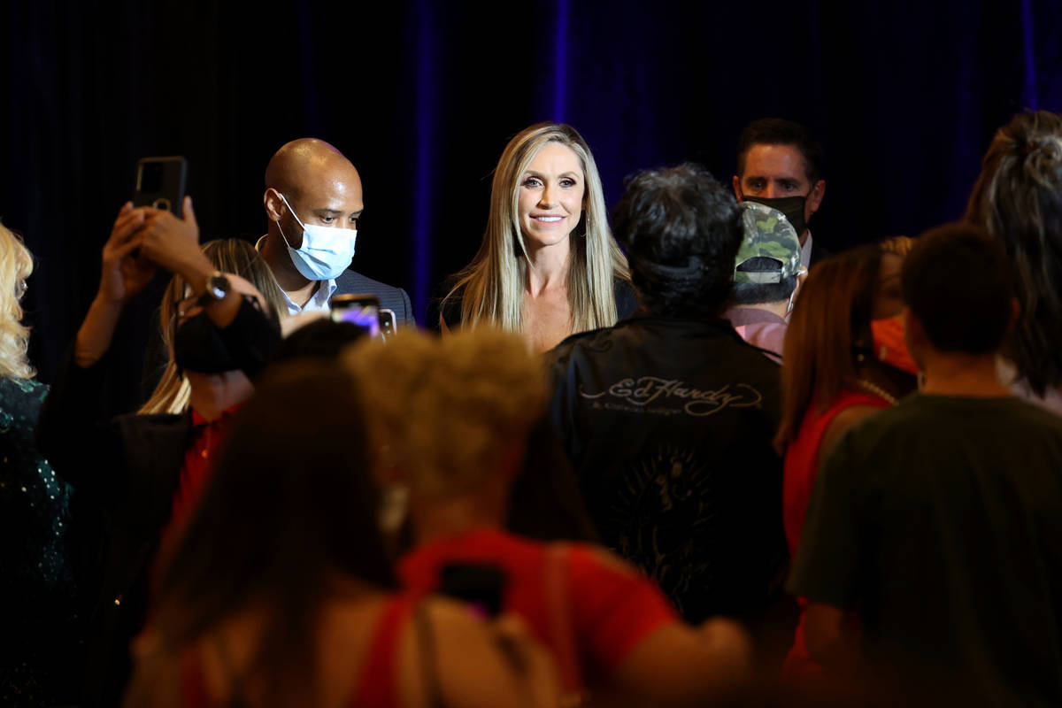 Lara Trump, daughter-in-law of President Donald Trump and wife of Eric Trump, poses with fans a ...