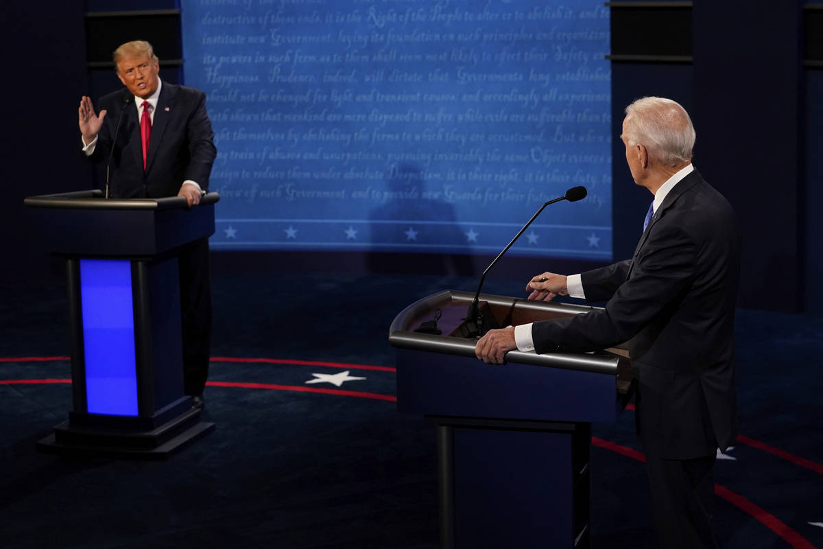 President Donald Trump answers a question as Democratic presidential candidate former Vice Pres ...