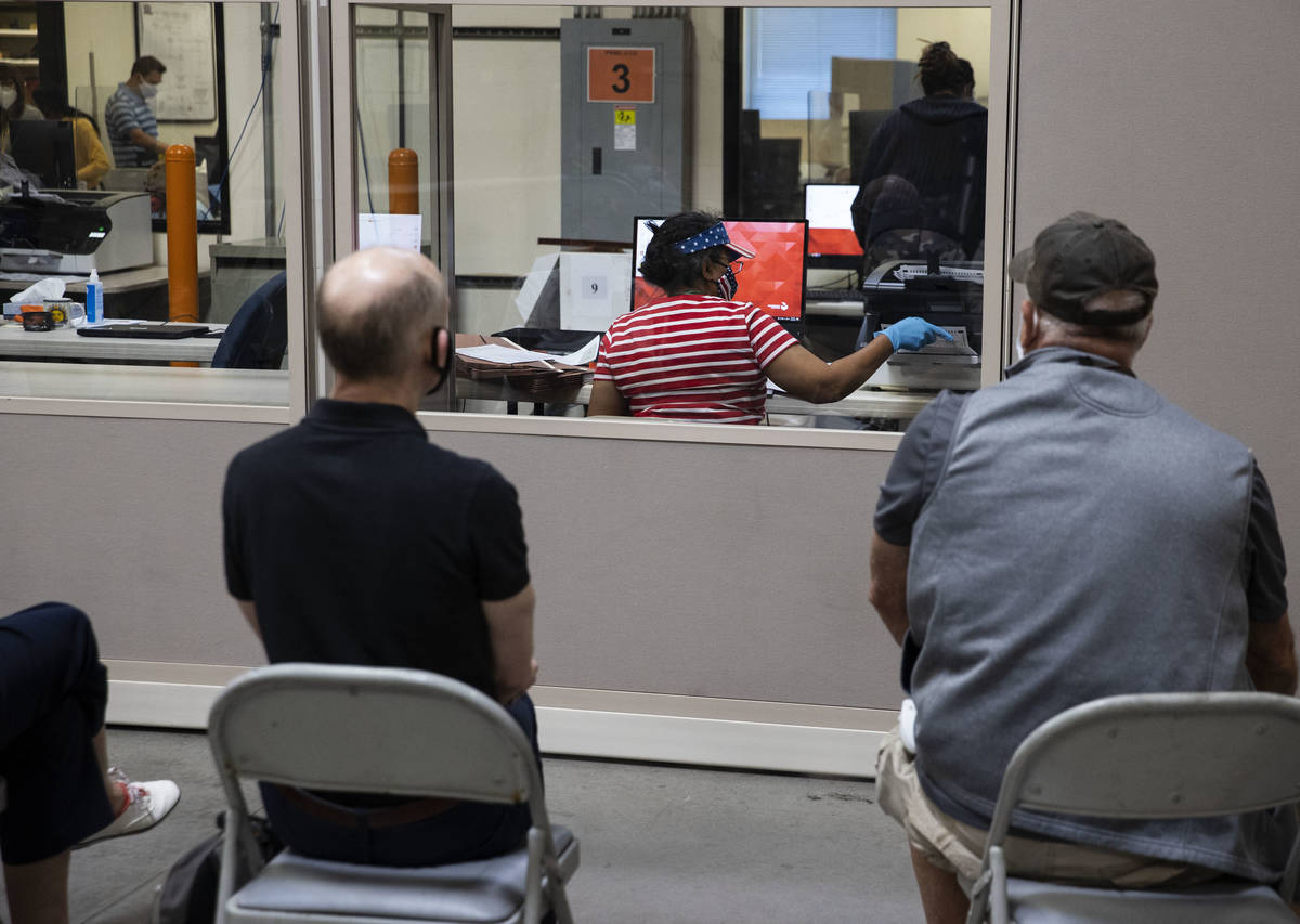 Election observers watch as Clark County election workers count ballots at the Election Departm ...