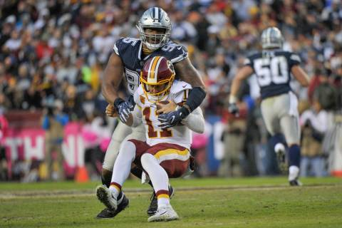 Washington Redskins quarterback Alex Smith (11) is sacked by Dallas Cowboys defensive tackle Da ...