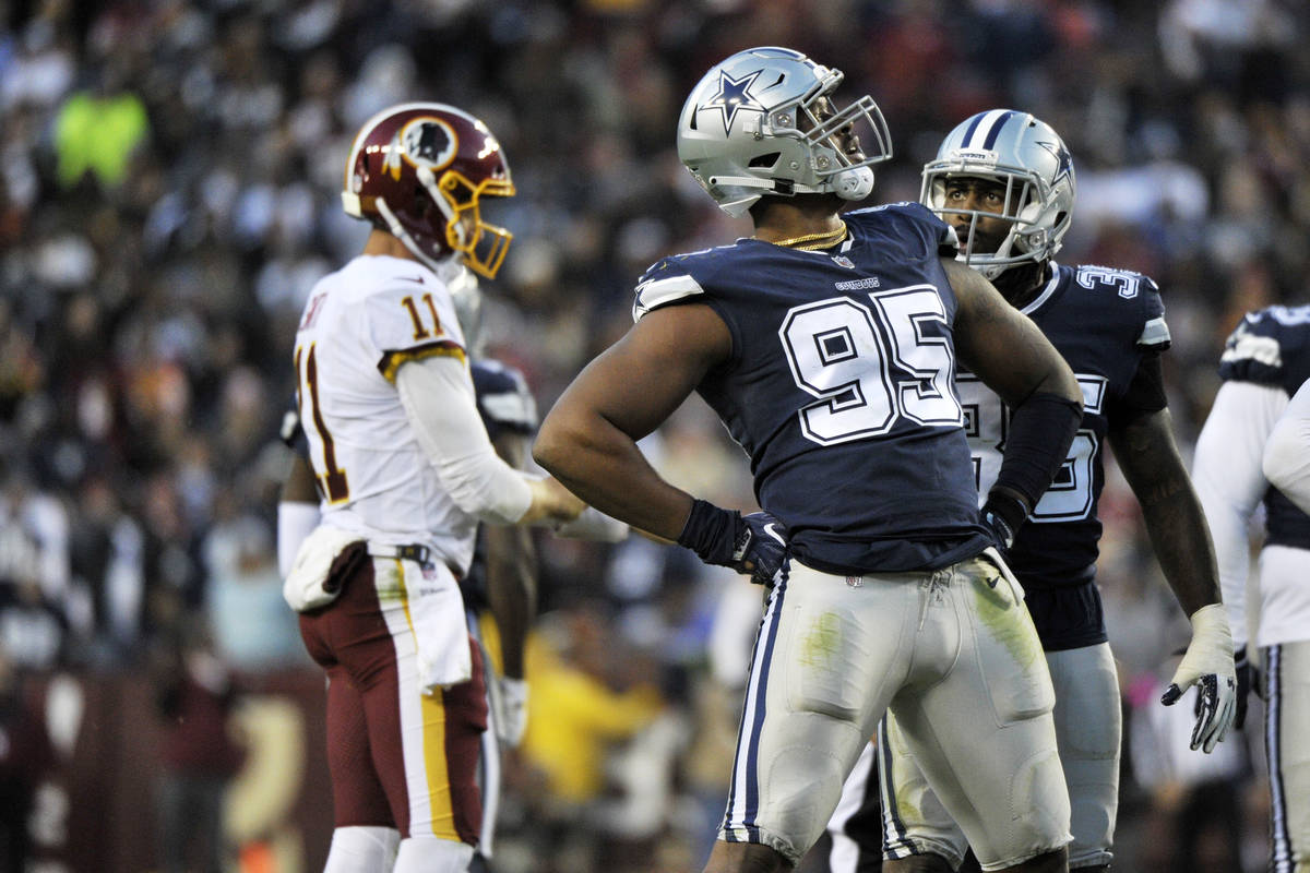 Dallas Cowboys defensive tackle David Irving (95) celebrates a sack during an NFL football game ...