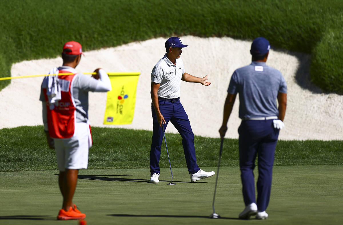 Rickie Fowler reacts after putting on the 18th green during the second round of the CJ Cup golf ...