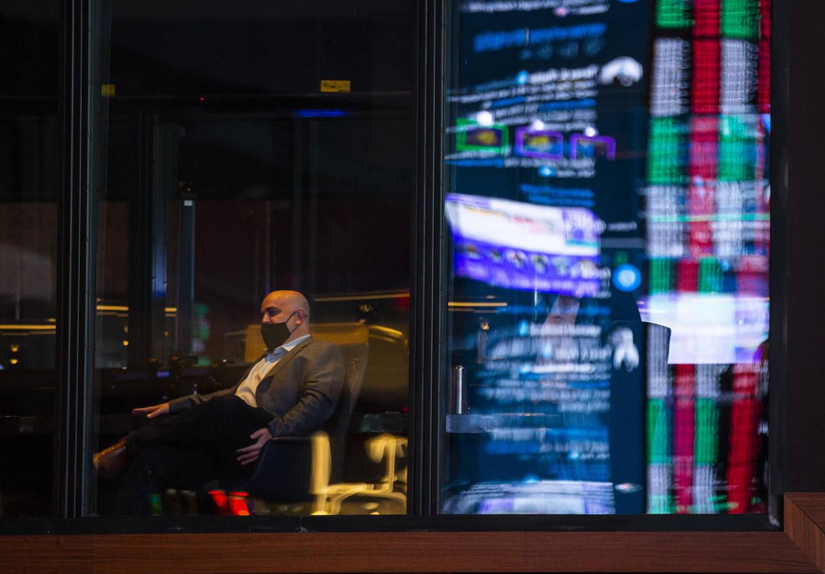 Brian Musburger, CEO of VSiN, is seen through a window near the Circa Sportsbook during a tour ...