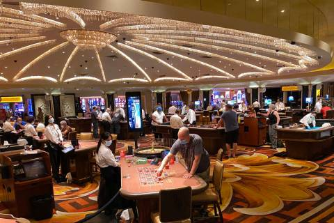 Gamblers don protective face masks at Caesars Palace on the Las Vegas Strip in this June 24, 20 ...