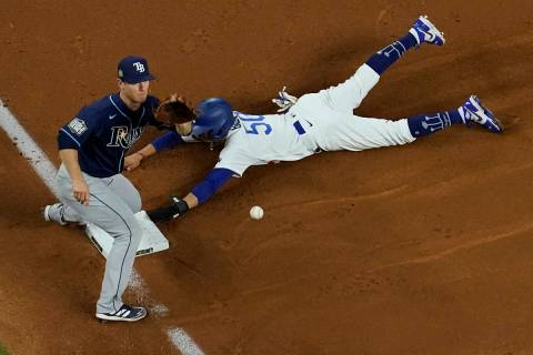 Los Angeles Dodgers right fielder Mookie Betts steals third past Tampa Bay Rays third baseman J ...