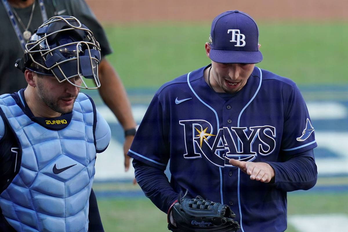 Tampa Bay Rays pitcher Blake Snell talks to catcher Mike Zunino during the second inning in Gam ...