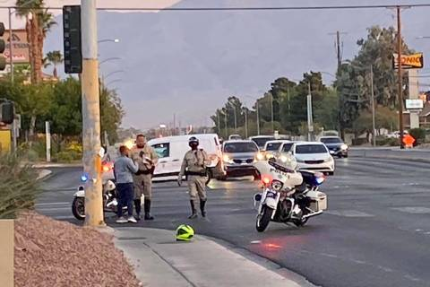 Police at the scene of a motorcycle crash at North Decatur Boulevard and West Craig Road on Wed ...