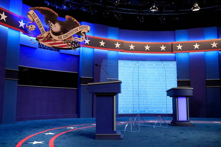Clear protective panels stand onstage between lecterns for President Donald Trump and Democrati ...