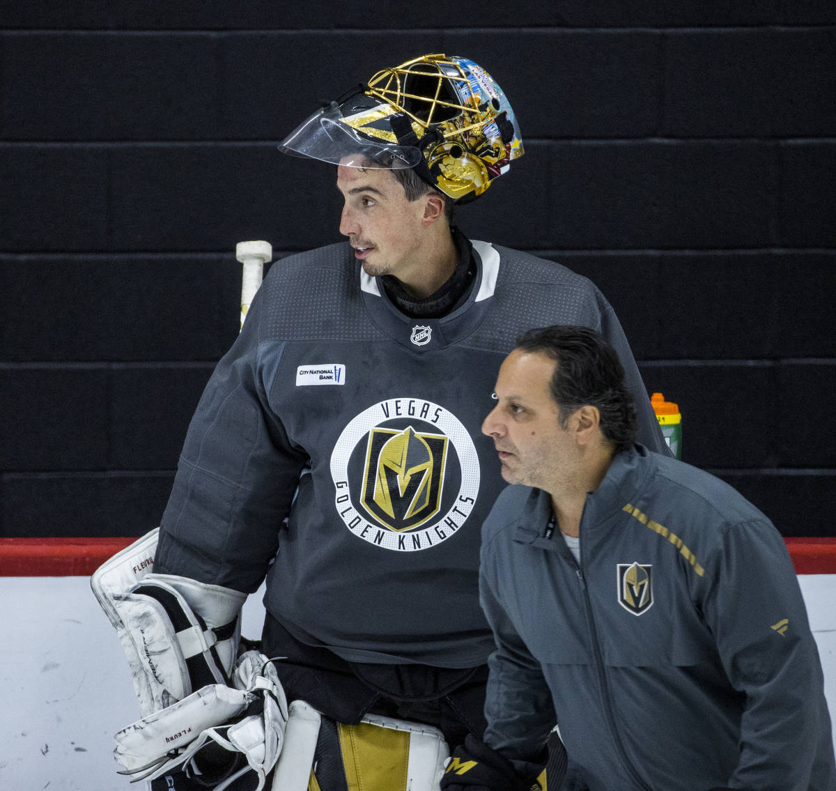 Vegas Golden Knights goaltender Marc-Andre Fleury (29, top) looks up the ice with goaltending c ...
