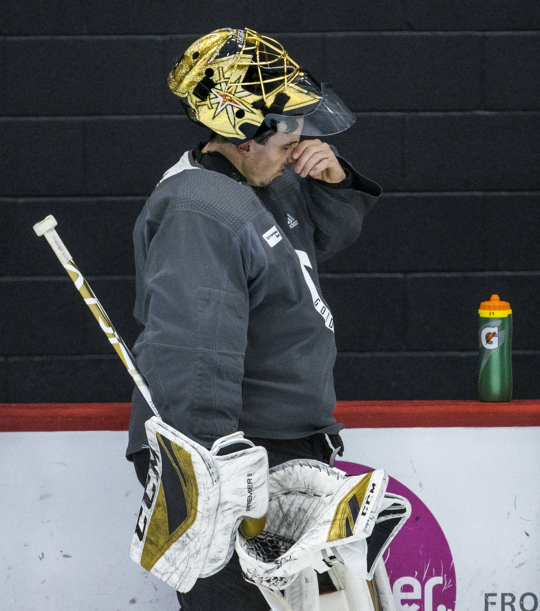 Vegas Golden Knights goaltender Marc-Andre Fleury (29) checks his nose during a break in practi ...