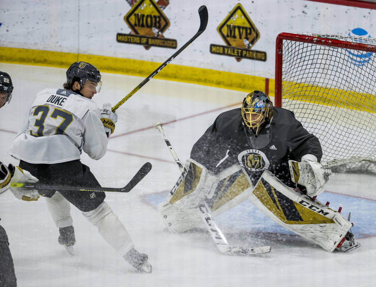 Vegas Golden Knights center Reid Duke (37, left) stops short of goaltender Marc-Andre Fleury ( ...