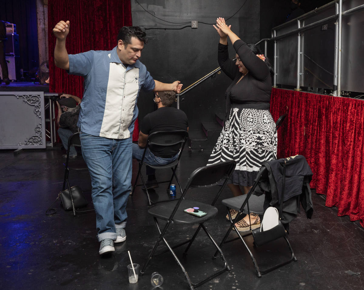 Rey Castillo, 43, of Los Angeles, left, dances with Veronica Berdugo, 37, of Los Angeles while ...