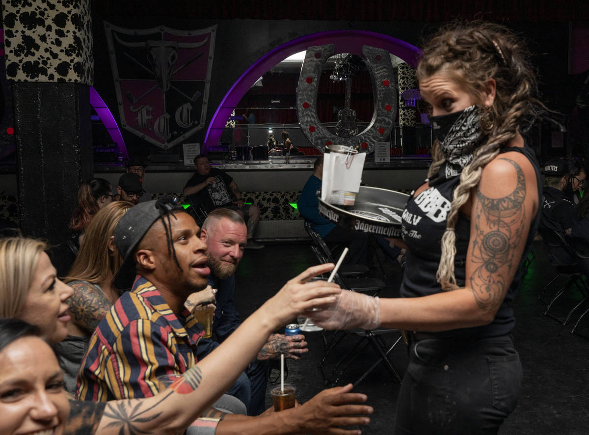 Bar tender Arinetta McGarvey delivers drinks to concert goers in their seats during Shanda &amp ...