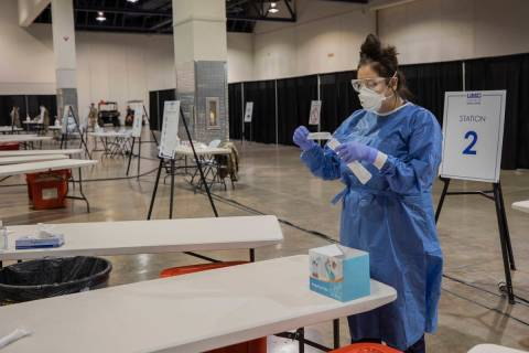 UMC respiratory therapist Diana Vega prepares tests during a preview of COVID-19 testing site i ...