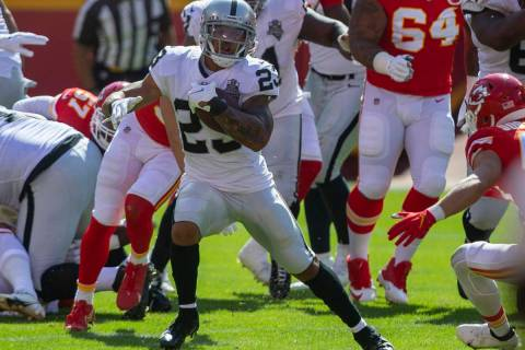 Las Vegas Raiders running back Devontae Booker (23) runs with the football against the Kansas C ...