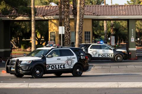 The LVMPD investigate a barricade situation involving a man not allowing a female and child to ...