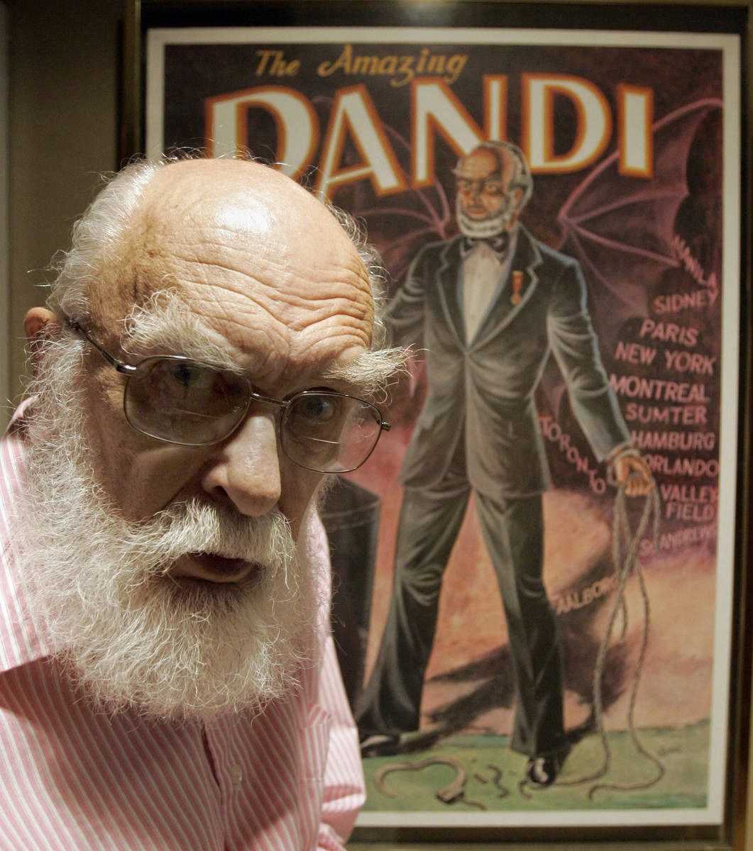 FILE - In this Friday, June 29, 2007, file photo, James Randi is shown in front of a poster at ...