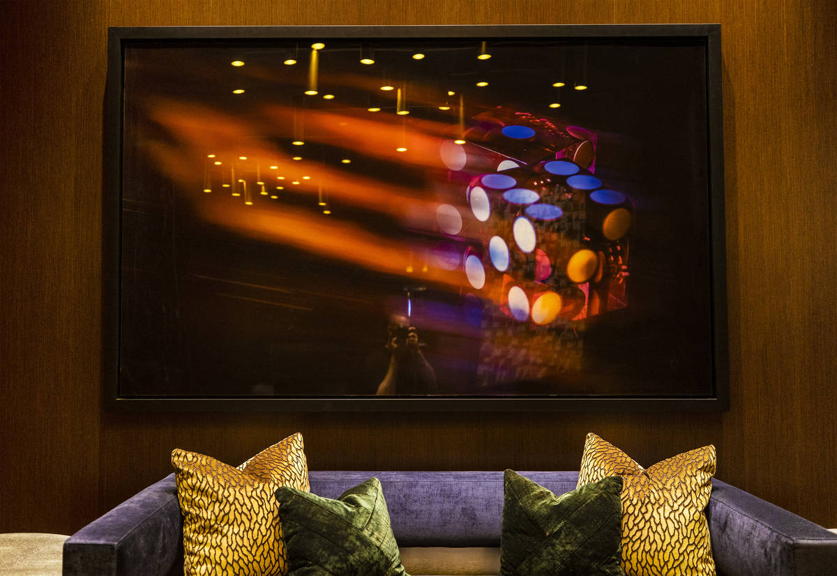 Gambling-themed art lines the walls of the VIP check in area at Circa on Monday, Oct. 19, 2020, ...