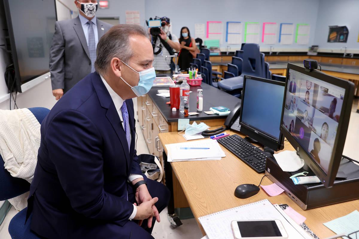 Clark County School District Superintendent Jesus Jara, center, greets distance learning studen ...