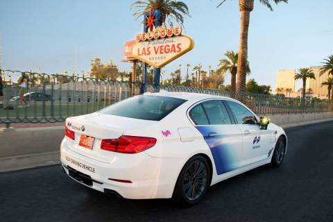 An autonomous Motional BMW 5 Series vehicle part of the Lyft program passes the Welcome to Las ...