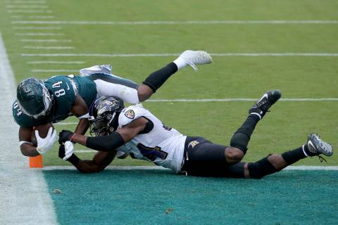 Philadelphia Eagles wide receiver Greg Ward (84) dives for a two-point conversion against Balti ...