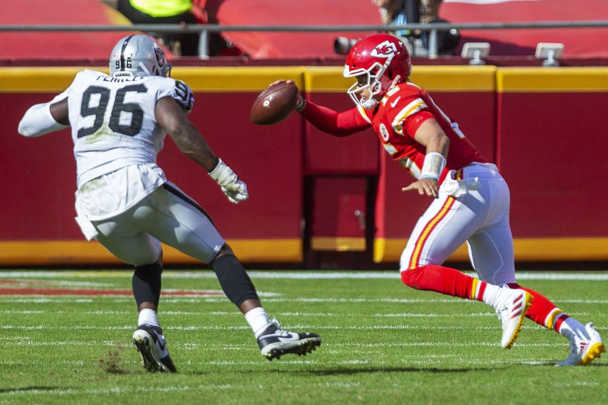 Las Vegas Raiders defensive end Clelin Ferrell (96) pressures Las Vegas Raiders wide receiver N ...