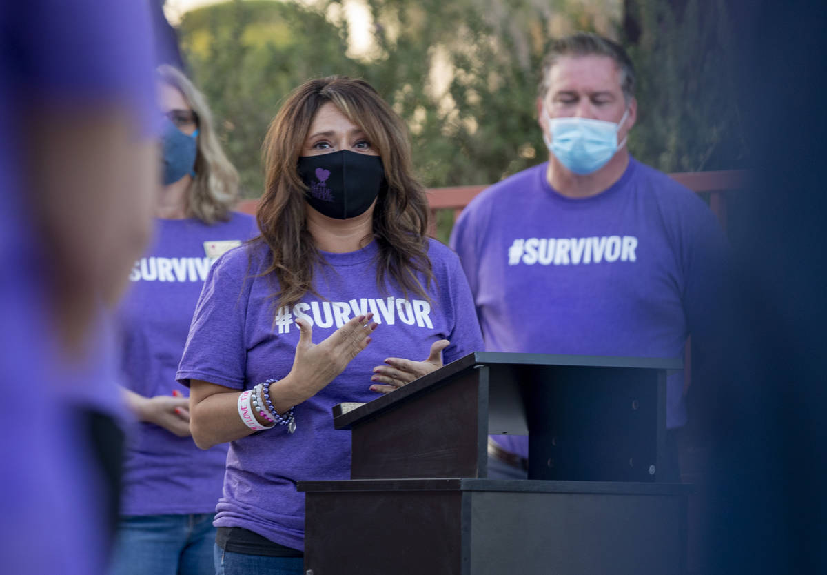 The Shade Tree CEO Linda Perez speaks before a candlelight vigil to honor domestic violence vic ...
