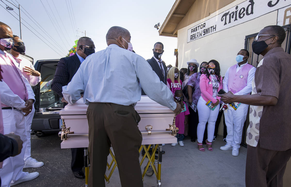Family and friends gather outside as the casket is brought inside for the funeral service for S ...