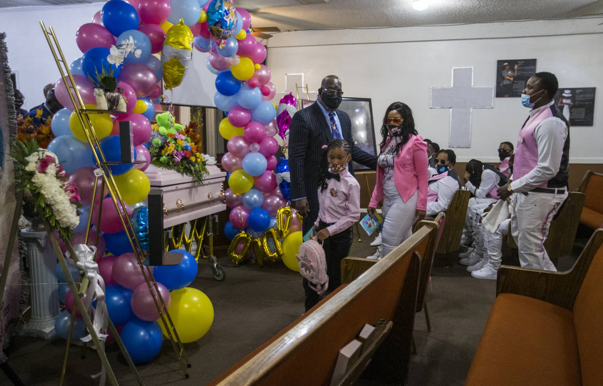 Family members arrive in the chapel for the funeral service for Sayah Deal at the Tried Stone B ...